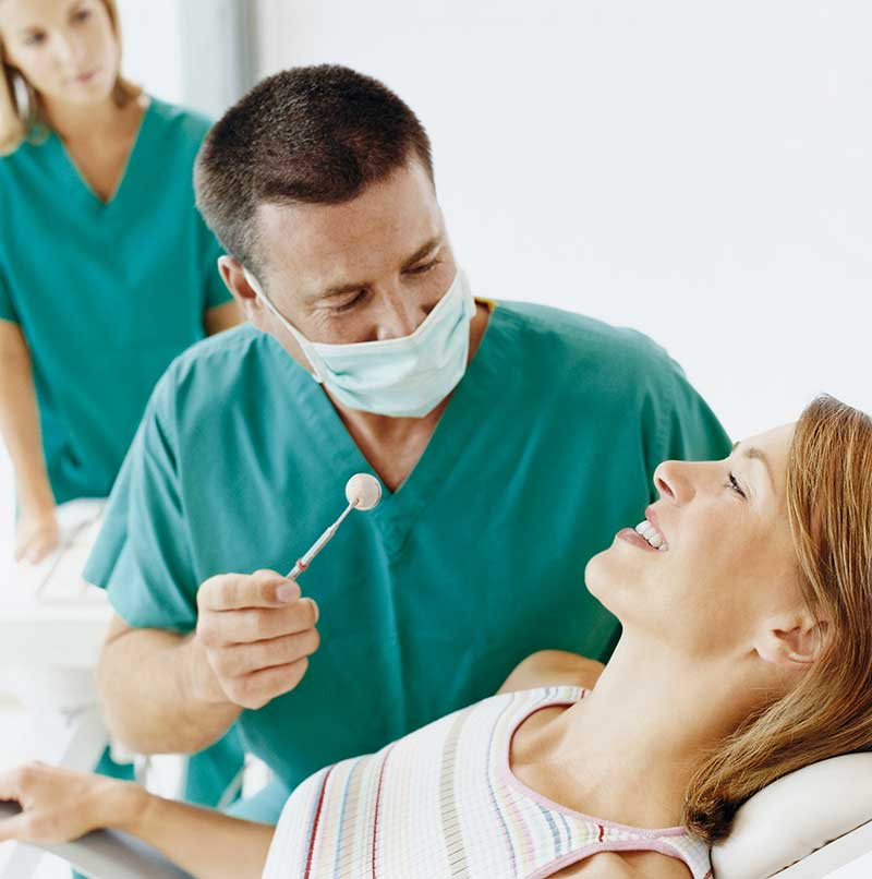 Dentist working on a patient with dental anxiety