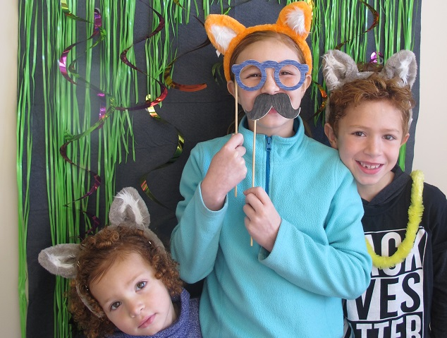 Three children with animal ear headbands.