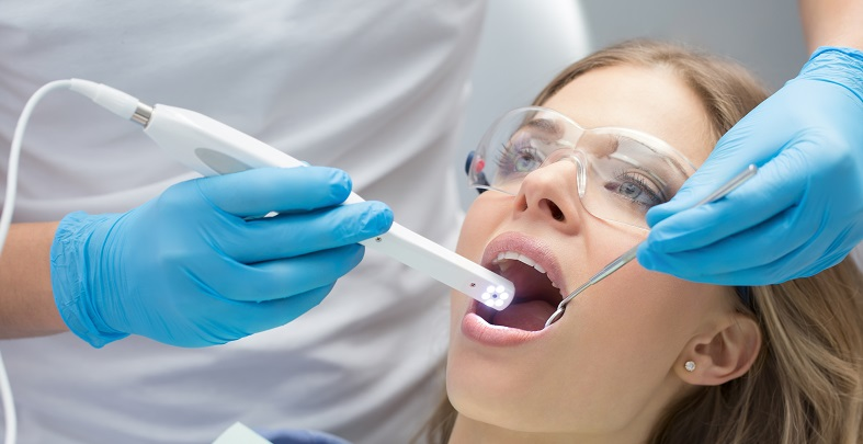 Patient being examined with and intra-oral camera