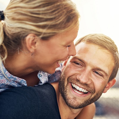 Closeup, loving couple with healthy smiles through gum laser therapy.